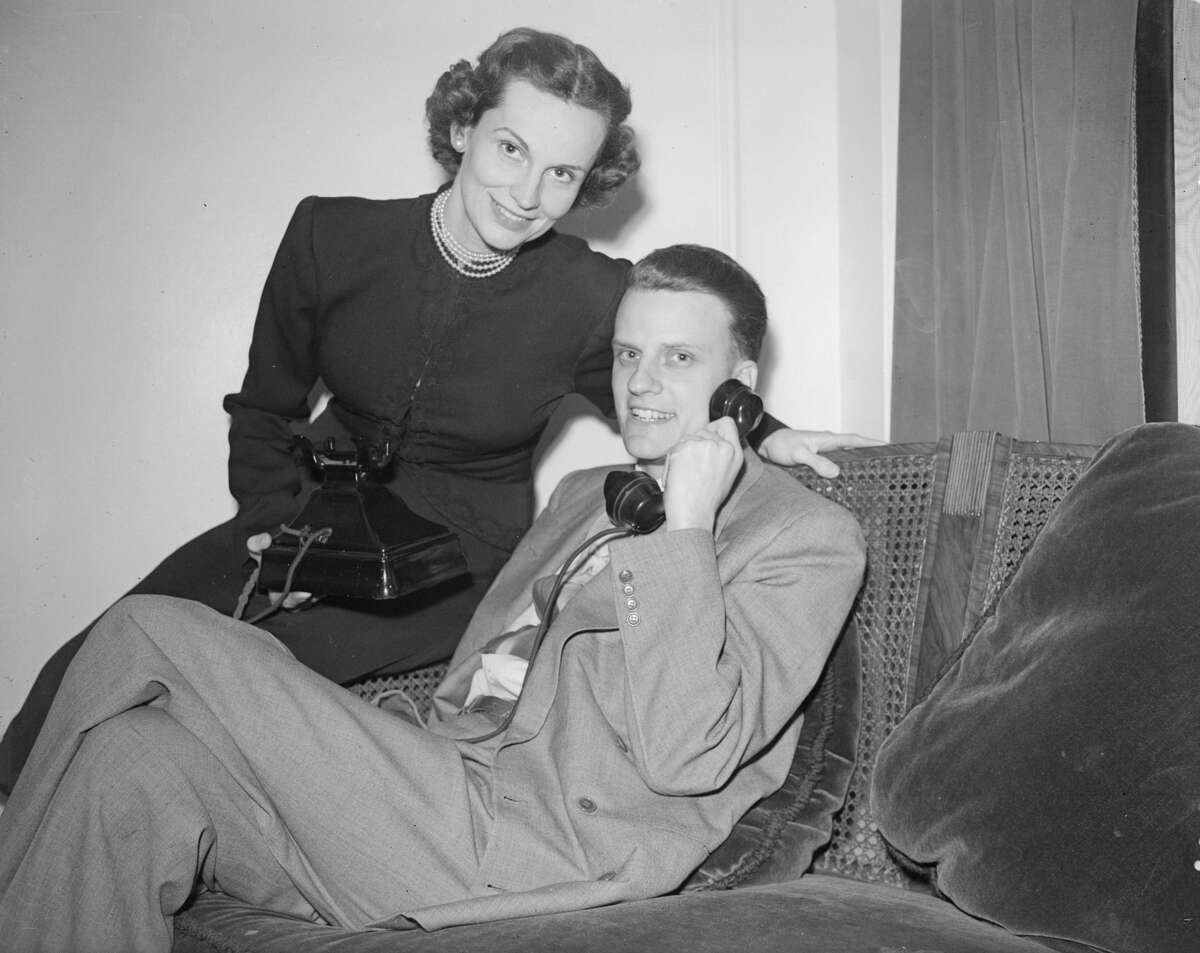 13th March 1952: American Christian evangelist Billy Graham at home with his wife.