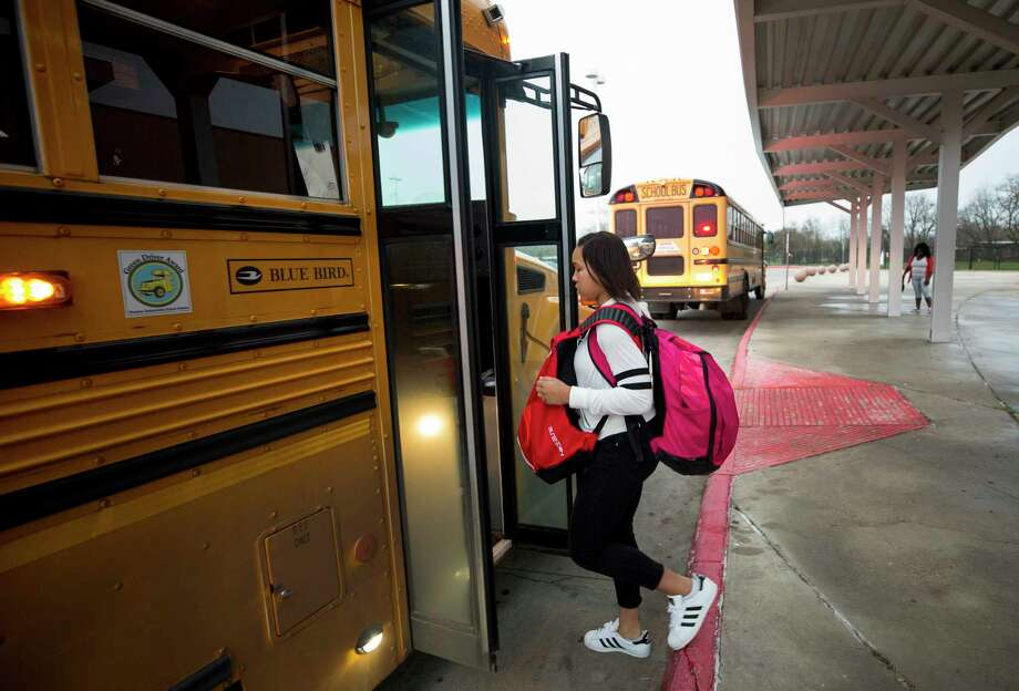 Fifteen-year-old Nia McGee boards the HISD bus that takes her to Bellaire High School Thursday, Feb. 15, 2018, in Houston. Nia, who lives in Sunnyside, takes the 10-mile bus ride to a school with more resources. Photo: Godofredo A. Vasquez / Godofredo A. Vasquez
