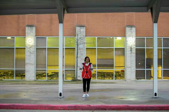 Fifteen-year-old Nia McGee, center, alongside her mother Nikea McGee waits for the HISD bus, at Bastian Elementary, that takes her to Bellaire High School Thursday, Feb. 15, 2018, in Houston. Nia, who lives in Sunnyside, takes the 10-mile bus ride to a school with more resources.
