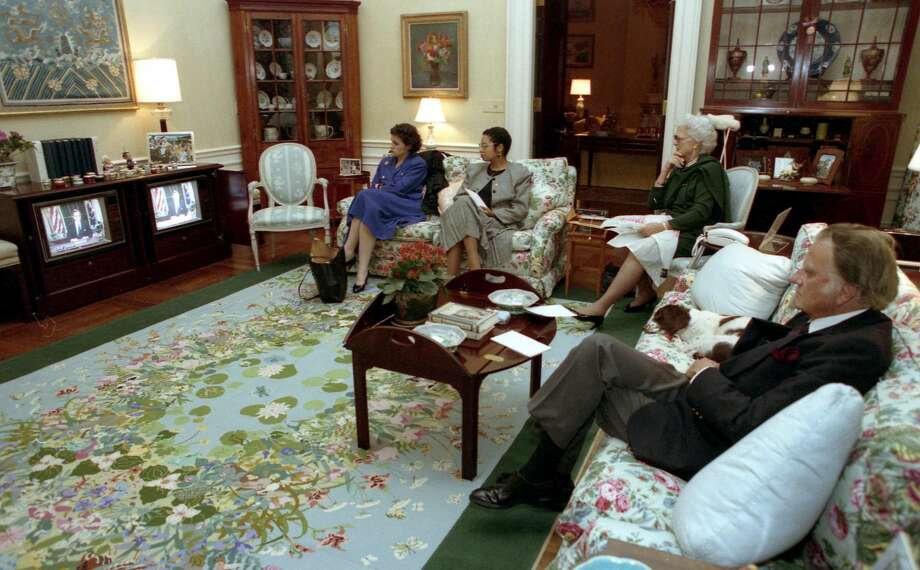 Reverend Graham watches President Bush announce the start of Operation Desert Storm on January 16, 1991 in the White House residence together with Mrs. Bush, her daughter Doro Bush, and press secretary to the First Lady Anna Perez. Photo: Credit: George Bush Presidential Library