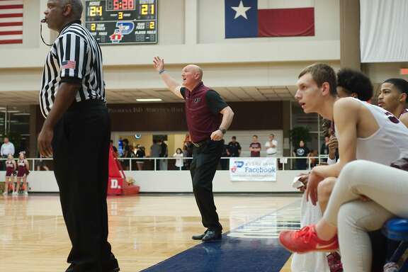 Pearland basketball coach Steve Buckelew  gives instructions from the sideline against Clear Creek Tuesday, Feb. 20 at Pasadena ISD Phillips Field House.