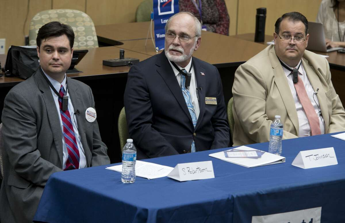 Candidates for Midland County Judge, Stephen Robertson, Terry Johnson and James Beauchamp, speak and answer questions 02/20/18 evening at the League of Women Voters candidate forum. Tim Fischer/Reporter-Telegram