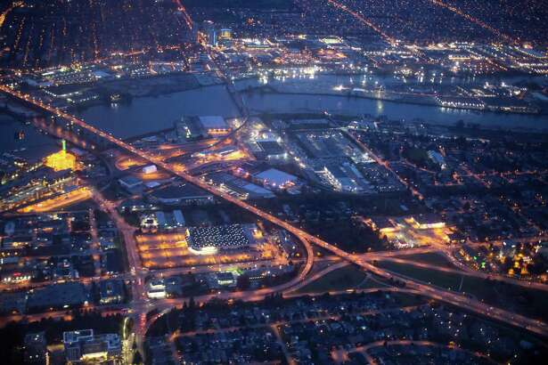 City lights are seen illuminated at night in this aerial photograph taken over Vancouver, British Columbia, Canada. (