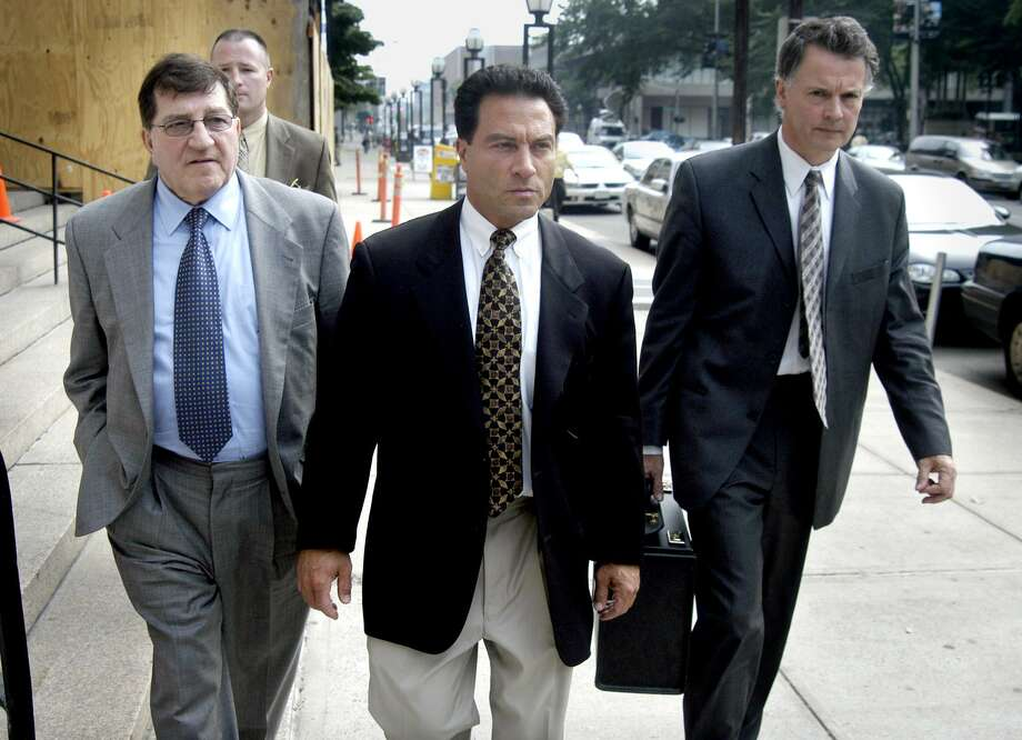 Alfred Lenoci Jr. (right) leaves the Federal Courthouse in New Haven, Conn. after being sentenced to 18 months in prison On the left is Alfred Lenoci Sr. Photo: Jeff Bustraan / File Photo / Connecticut Post file photo
