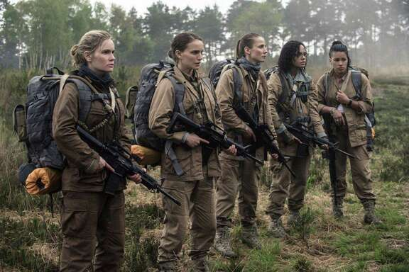 "Filmmaker Alex Garland has been accused of white-washing the lead characters in ""Annihilation."" In the book on which the film is based, the character played by Jennifer Jason Leigh, left, is of half American Indian descent and that of Natalie Portman is Asian."