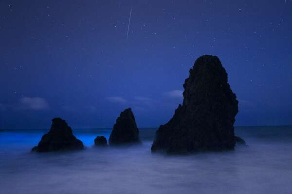 Rare phenomenon called bioluminescence�sets tide waters aglow at Rodeo Beach captured in a rare photograph with meteor by night-sky photographer�Tony�Rowell
