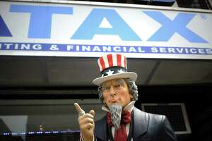 File photo of an Uncle Sam statue outside of a tax preparation office. (Anthony Behar/Sipa USA/TNS)