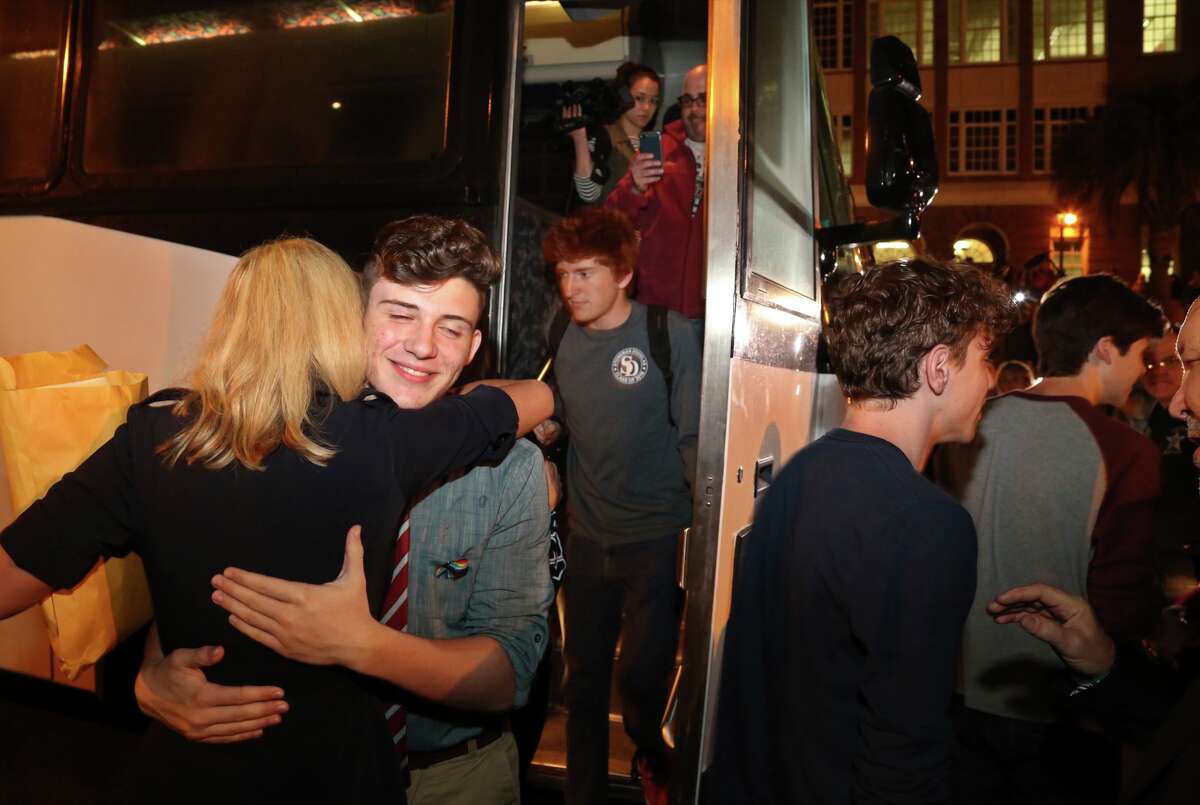 Alfonso Calderon, 16, left, a junior at Marjory Stoneman Douglas High School, Parkland, gets a hug from Florida State Sen. Lauren Book as 100 students arrive at Leon High School in Tallahassee, Tuesday, Feb. 20, 2018. (Scott Keeler/Tampa Bay Times via AP)