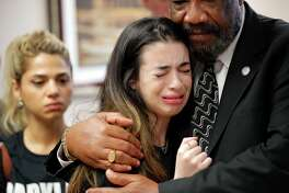 Aria Siccone, 14, a 9th grade student survivor from Marjory Stoneman Douglas High School, where more than a dozen students and faculty were killed in a mass shooting on Wednesday, cries as she recounts her story from that day, while state Rep. Barrinton Russell, D-Dist. 95, comforts her, as they talk to legislators at the state Capitol regarding gun control legislation, in Tallahassee, Fla., Wednesday, Feb. 21, 2018. (AP Photo/Gerald Herbert)