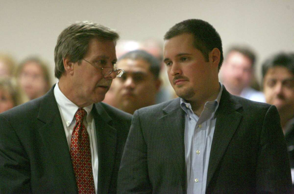 Bart Whitaker speaks with his attorney, Randy McDonald after a jury in Fort Bend County returned a guilty verdict in his capital murder trial. Whitaker was accused of killing his mother and brother in their Sugar Land home as part of a plot to inherit money.