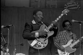"""Photo byWatt M. Casey Jr. ofB. B. King and the black Gibson ES-355 hollow-body guitar he called """"Lucille"""" included in Casey's book """"My Guitar Is a Camera"""" published by Texas A& University Press"""
