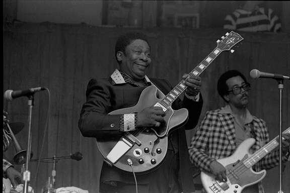 "Photo by Watt M. Casey Jr. of B. B. King and the black Gibson ES-355 hollow-body guitar he called ""Lucille"" included in Casey's book ""My Guitar Is a Camera"" published by Texas A& University Press"