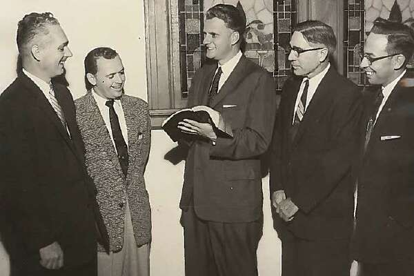 From left, Howard Hicks, general manager of the Beaumont Chamber of Commerce; the Rev. W.W. Kennedy of Cove Baptist Church of Orange; evangelist Billy Graham; the Rev. Frank L. Grayer, pastor of First Baptist Church of Groves; and Dr. H.E. Pickard, pastor of St. Andrew's Presbyterian Church of Beaumont, talk at the Roberts Avenue Methodist Church on Monday, Nov. 19, 1956. Enterprise file photo