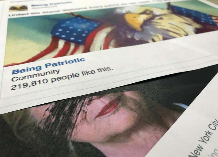 """A Facebook posting, released by the House Intelligence Committee, for a group called """"Being Patriotic"""" is photographed in Washington, Friday, Feb. 16, 2018. A federal grand jury indictment on Feb. 16, charging 13 Russians and three Russian entities with an elaborate plot to interfere in the 2016 U.S. presidential election, noted that beginning in June 2016, defendants and and their co-conspirators organized and coordinated political rallies in the U.S. The """"Being Patriotic"""" promoted and organized two political rallies in New York according to the indictment. (AP Photo/Jon Elswick)"""
