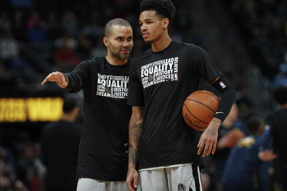 San Antonio Spurs guard Tony Parker (9) and San Antonio Spurs guard Dejounte Murray (5) in the second half of an NBA basketball game Tuesday, Feb. 13, 2018, in Denver. The Nuggets won 117-109. (AP Photo/David Zalubowski) Photo: David Zalubowski, STF / Associated Press / Copyright 2018 The Associated Press. All rights reserved.