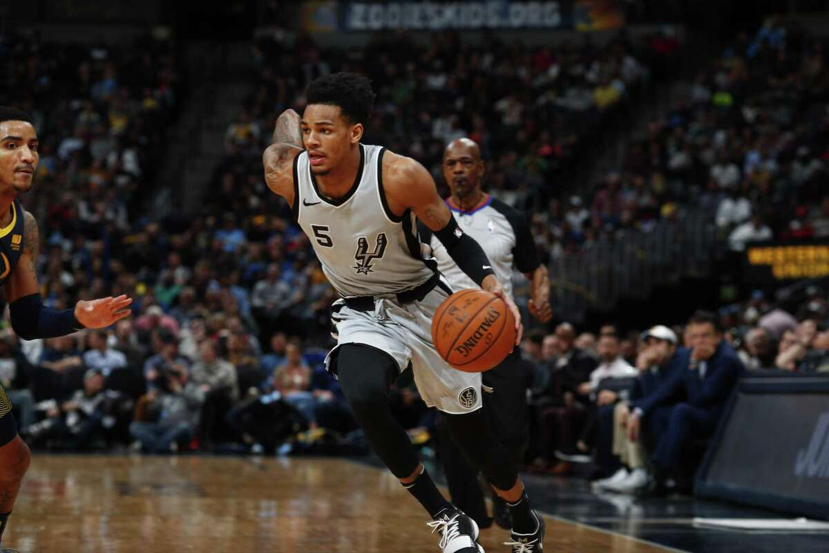 San Antonio Spurs guard Dejounte Murray (5) in the second half of an NBA basketball game Tuesday, Feb. 13, 2018, in Denver. The Nuggets won 117-109. (AP Photo/David Zalubowski)