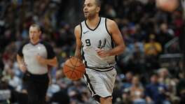San Antonio Spurs guard Tony Parker (9) in the second half of an NBA basketball game Tuesday, Feb. 13, 2018, in Denver. The Nuggets won 117-109. (AP Photo/David Zalubowski)