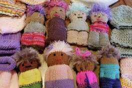 A charity knit-along will be held Saturday at In Sheep's Clothing in Torrington. Participants can learn to make these charming dolls.