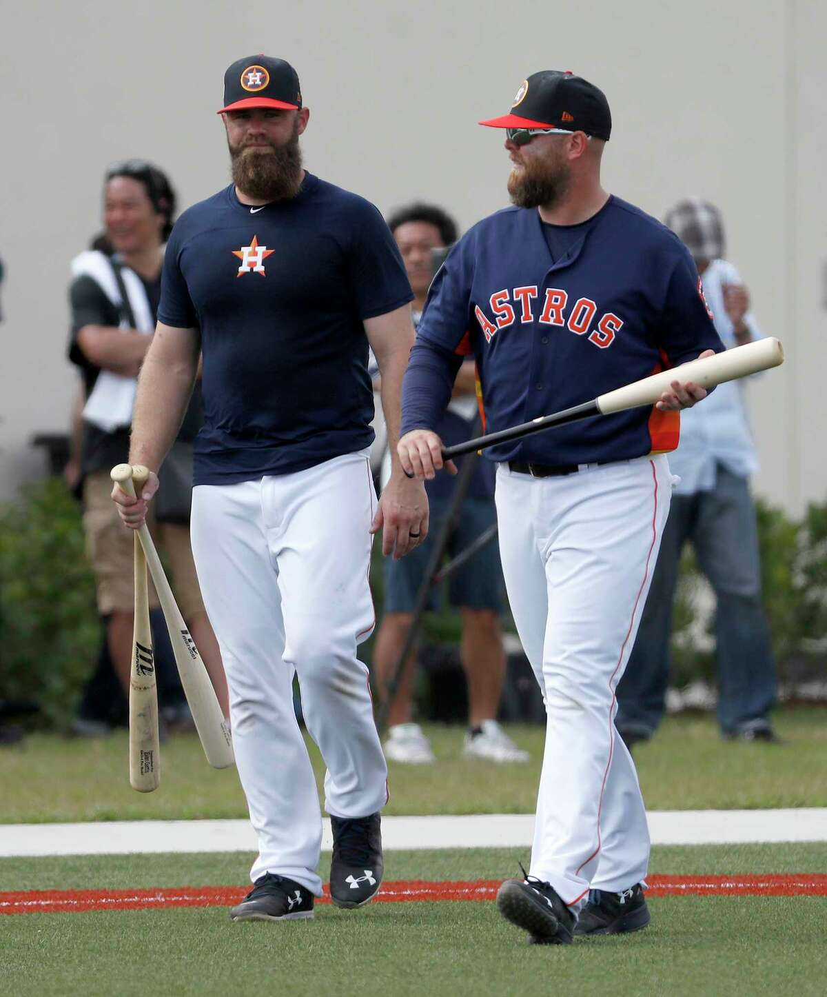 Houston Astros catchers Evan Gattis (11), Brian McCann (16) walk to another field during spring training at The Ballpark of the Palm Beaches, Wednesday, Feb. 21, 2018, in West Palm Beach.