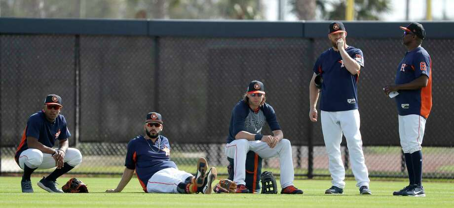 Houston Astros outfielders Tony Kemp (18), Marwin Gonzalez (9), Josh Reddick (22), Derek Fisher (21), and third base coach Gary Pettis (8) wait their turn for a drill during spring training at The Ballpark of the Palm Beaches, Wednesday, Feb. 21, 2018, in West Palm Beach. Photo: Karen Warren, Houston Chronicle / © 2018 Houston Chronicle
