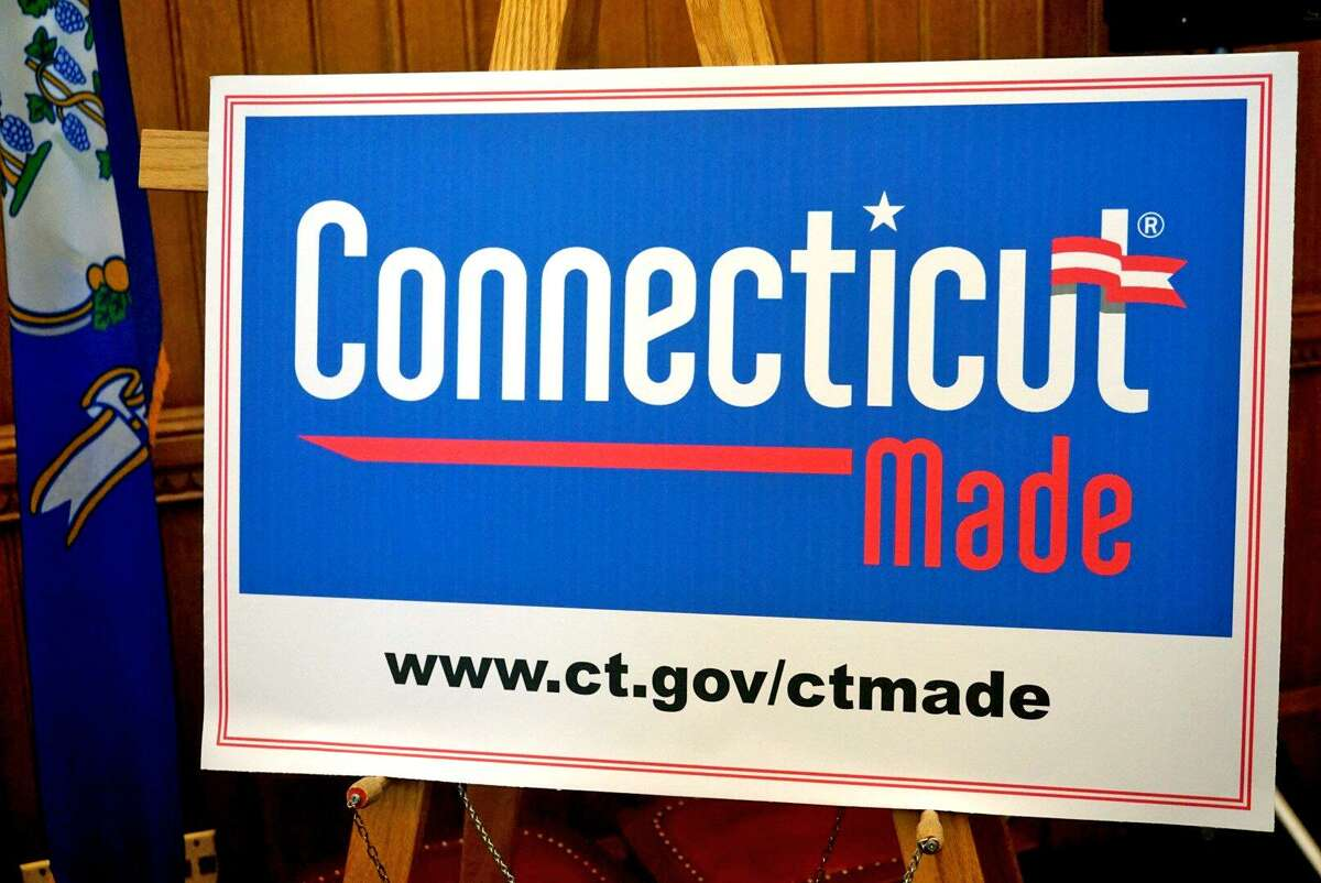 """Legislators unveiled a new """"Connecticut Made"""" logo at the Capitol in Hartford, Conn. on Wednesday, Feb. 21, 2018 to promote products created in the state."""