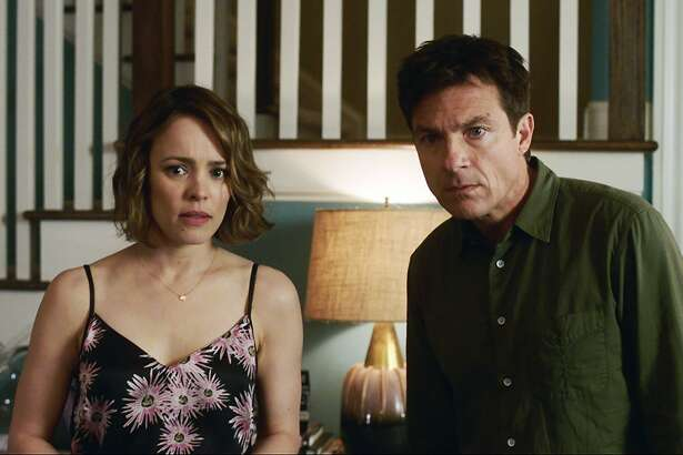 "This image released by Warner Bros. Entertainment shows Rachel McAdams, left, and Jason Bateman in a scene from ""Game Night."" (Warner Bros. Entertainment via AP)"