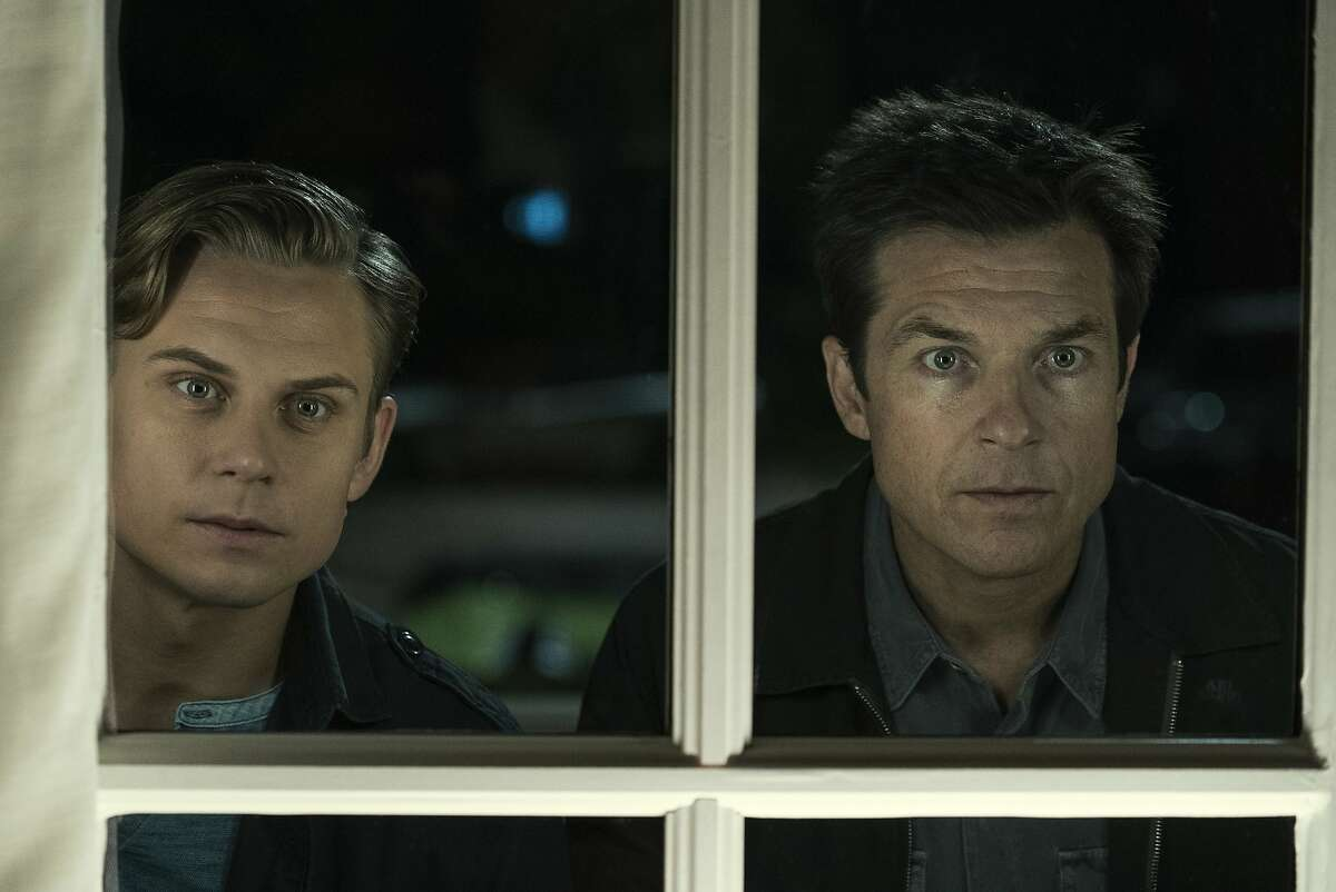 """This image released by Warner Bros. Entertainment shows Billy Magnussen, left, and Jason Bateman in a scene from """"Game Night."""" (Hopper Stone/Warner Bros. Entertainment via AP)"""