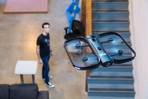 The Skydio R1, an autonomous drone, with a mobile device at the company's office in Redwood City, Calif., Feb. 8, 2018. A group of artificial intelligence researchers and policymakers from prominent labs and think tanks in both the United States and Britain released a report that described how rapidly evolving and increasingly affordable A.I. technologies could be used for malicious purposes. (Laura Morton/The New York Times)