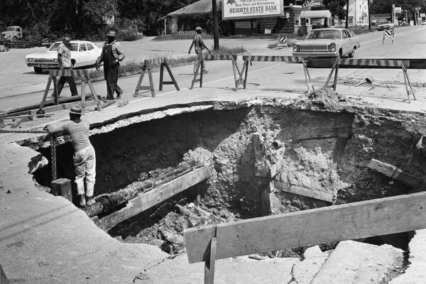 10/04/1968 - A big hole opened up in the 2800 block of White Oak in north Houston when a leaking storm sewer caused a gas main to break. Initially, workmen dug a small hole to fix the gas main; but as the sewer leak continued overnight, the road collapsed in the middle of Saturday night and the large hole was created. The collapse caused a second water main to break so White Oak was closed to traffic between Studemont and Oxford.