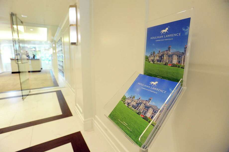 Real estate brochures on display at the greenwich conn office of houlihan lawrence during