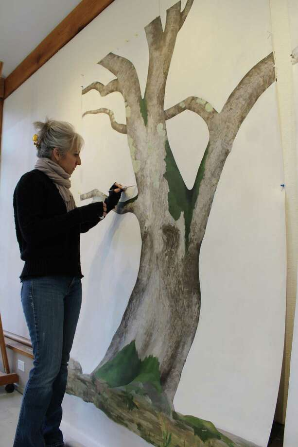 Kazaan Viveiros, Weir Farm National Site's artist-in-residence for February, touches up the paint on two of her latest pieces — one an image of an oak tree, the other a sycamore tree — on Tuesday, Feb. 20, 2018. Photo: Pat Tomlinson / Hearst Connecticut Media