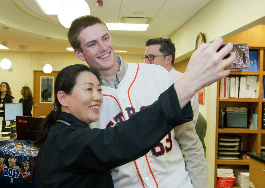 Houston Astros' Forrest Whitley poses for selfie with Yilan Quan during a stop as part of the Astros Caravan at Houston Methodist The Woodlands Hospital on Jan. 12. On Wednesday, Whitley was suspended 50 games for violating MLB's drug policy. Photo: Jason Fochtman, Staff Photographer / © 2018 Houston Chronicle