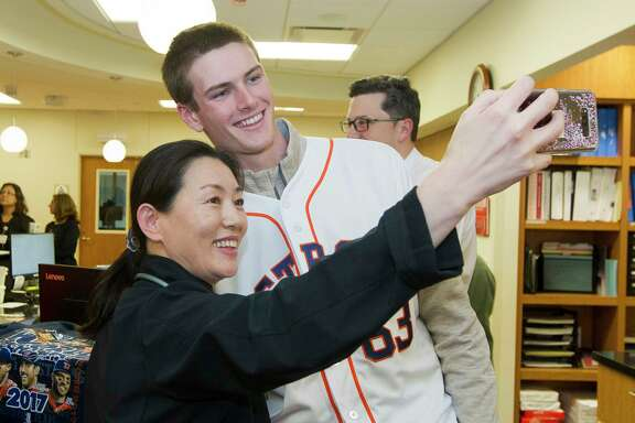 Houston Astros' Forrest Whitley poses for selfie with Yilan Quan during a stop as part of the Astros Caravan at Houston Methodist The Woodlands Hospital, Friday, Jan. 12, 2018, in The Woodlands.