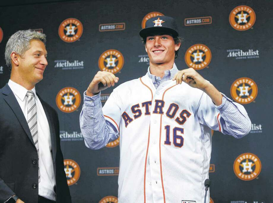 Forrest Whitley, who was selected with the 17th overall pick in the first round of the 2016 MLB First Year Player Draft, was introduced to the media by Astros Director of Amateur Scouting Mike Elias during a press conference after signing with the Astros, before the start of an MLB baseball game at Minute Maid Park, Wednesday, June 22, 2016, in Houston. ( Karen Warren  / Houston Chronicle ) Photo: Karen Warren, Staff / Internal
