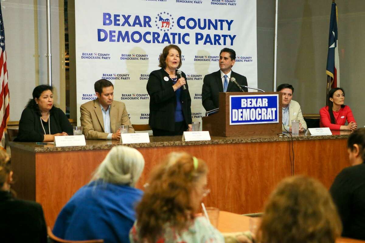 U.S. District 23 candidate Judy Canales (standing) speaks during a debate among Democratic candidates running for a chance to challenge Will Hurd in U.S. District 23 at Luby's, 911 N. Main, on Tuesday, Feb. 20, 2018.
