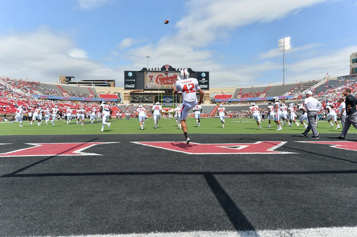 LUBBOCK, TX - SEPTEMBER 12: Taylor Symmank #42 of the Texas Tech Red Raiders warms up prior to the game against the UTEP Miners on September 12, 2015 at Jones AT&T Stadium in Lubbock, Texas.Texas Tech won the game 69-20. (Photo by John Weast/Getty Images)