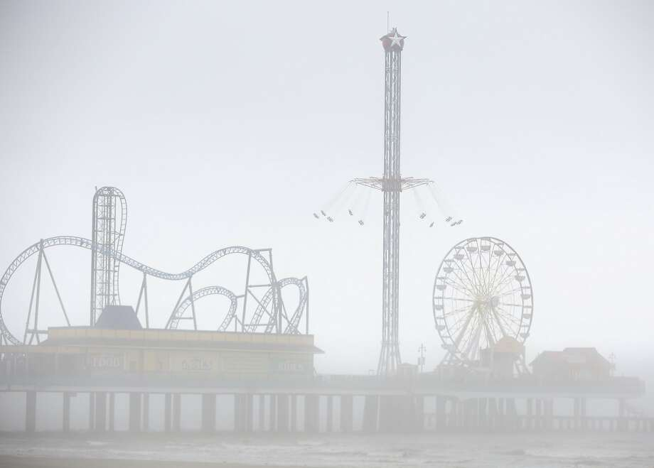 The Pleasure Pier is covered in fog before the Krewe d'Esprit Rosaire Parade on Saturday, Feb. 10, 2018, in Galveston. ( Yi-Chin Lee / Houston Chronicle ) Photo: Yi-Chin Lee, Houston Chronicle