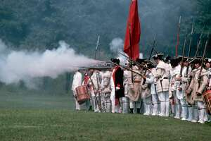 File photo of a Revolutionary War reenactment. A reenactment planned in Elk Grove, Calif. was recently cancelled due to local gun laws.