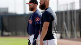 Astros catchers Brian McCann, left, and Evan Gattis could be taken for brothers.