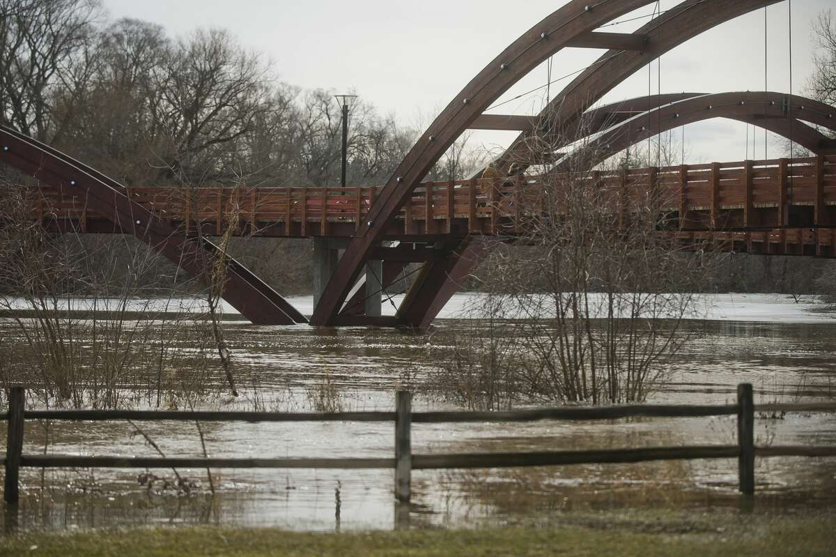 Chippewassee Park is partially flooded on Wednesday, Feb. 21, 2018. The river is expected to crest on Thursday at 26.4 feet. (Katy Kildee/kkildee@mdn.net)