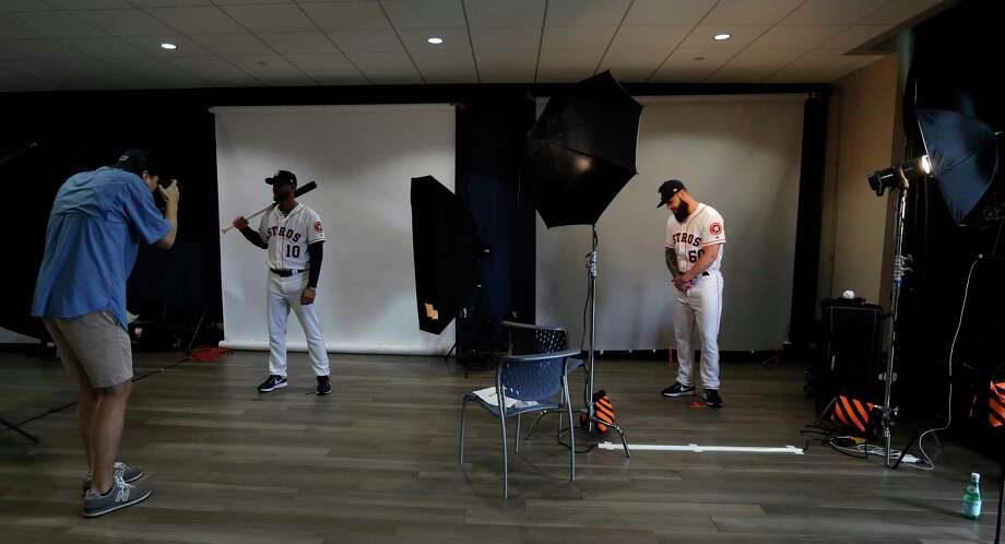 Houston Astros Yuli Gurriel (10) and pitcher Dallas Keuchel (60) get their photos taken during photo day at spring training at The Ballpark of the Palm Beaches, Wednesday, Feb. 21, 2018, in West Palm Beach.Browse through the photos for a look at every Astros player on picture day.  Photo: Karen Warren, Houston Chronicle / © 2018 Houston Chronicle