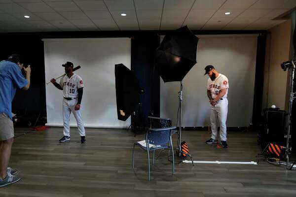 Houston Astros Yuli Gurriel (10) and pitcher Dallas Keuchel (60) get their photos taken during photo day at spring training at The Ballpark of the Palm Beaches, Wednesday, Feb. 21, 2018, in West Palm Beach.