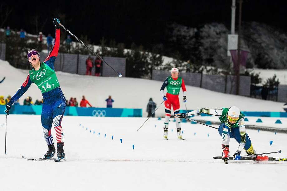 Jessica Diggins (left) exults as she crosses the finish line to win team gold for the U.S. as Sweden's Stina Nilsson places second. Photo: ODD ANDERSEN, AFP/Getty Images