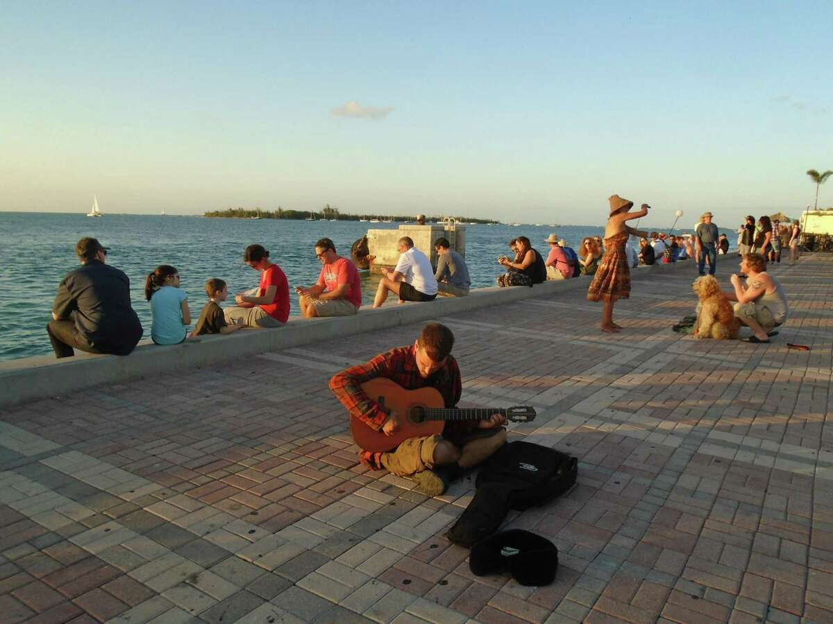 Crowds gather at Mallory Square for Key West sunset celebrations with locals and visitors every day.