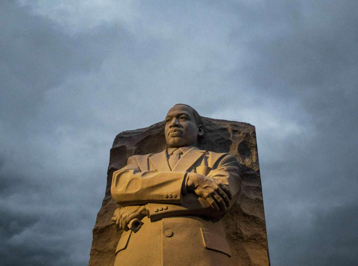 Early morning light shines on the Martin Luther King Jr. Memorial on the National Mall on Jan. 19, 2015, in Washington, D.C. Visitors gather at the Martin Luther King Jr. Memorial to celebrate MLK day.