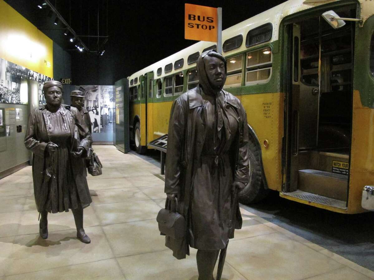 Statues of three women walking next to a replica of a city bus are part of an exhibit about Montgomery's bus boycotts at the National Civil Rights Museum in Memphis, Tenn. The museum, which first opened in 1991, was showing off new, emotionally-moving exhibits and flashy, informative interactive displays in 2014.