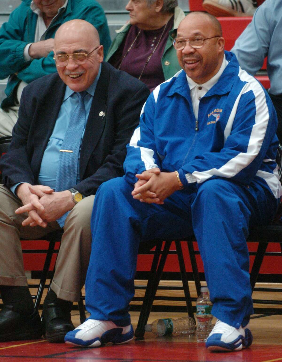 In this Feb. 26, 2008, file photo, longtime coaching rivals and friends Vito Montelli of St. Joseph High School, left, and Charlie Bentley of Harding High School share some bench time together just before their teams kicked off the FCIAC basketball semifinal at Fairfield Warde High School.