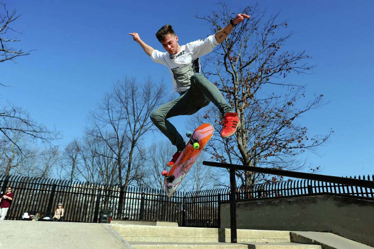 20-year-old Robby Kvenvik, of North Salem, N.Y., kicks his skateboard while doing a trick down stairs at the skatepark in Scalzi Park in Stamford, Conn. on Wednesday, Feb. 21, 2018.