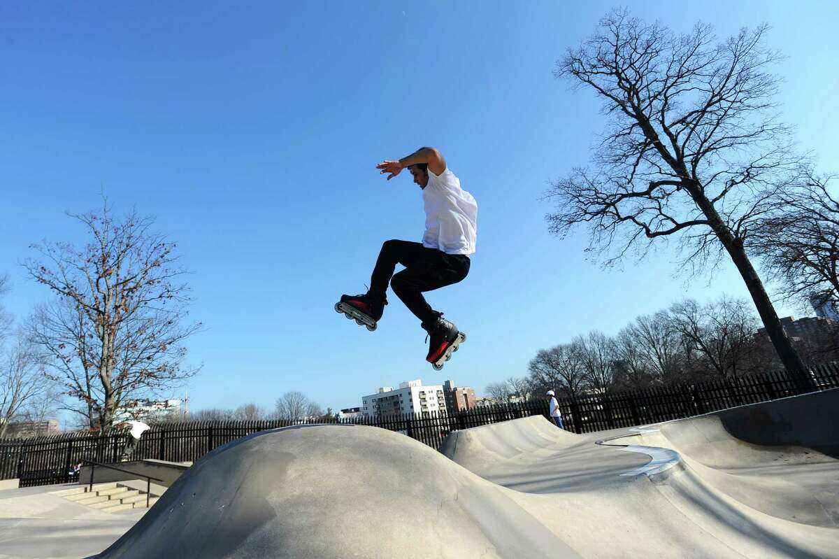 27-year-old Marcello Savona, of Stamford, flies through the air on rollerblades inside the skatepark at Scalzi Park in Stamford, Conn. on Wednesday, Feb. 21, 2018.