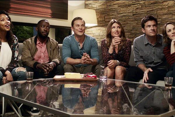 "(L-r) Kylie Bunbury, Lamorne Morris, Billy Magnussen, Sharon Horgan, Jason Bateman and Rachel McAdams in ""Game Night."""